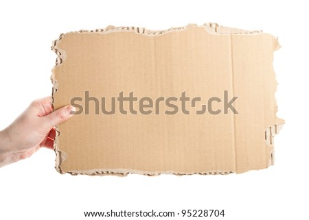 Female hand holding empty piece of cardboard isolated on white