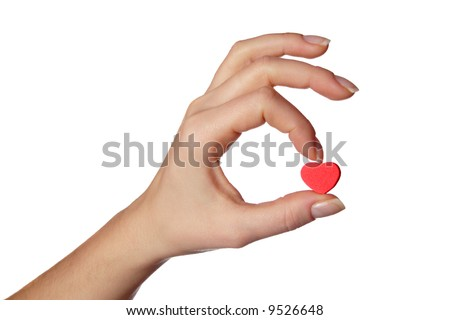 Female hand holding little red heart.Isolated on white.