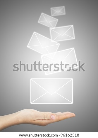 female hand holding or getting e-mail sign on a touch screen interface over grey background