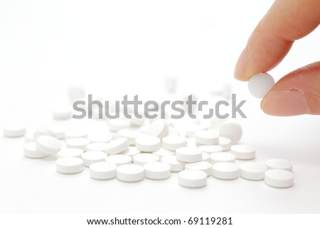 Female hand holding pill