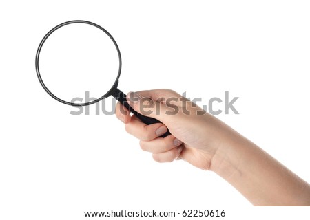 Female hand holding the magnifying glass (isolated)