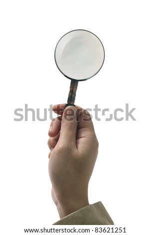 Female hand holding the magnifying glass on white