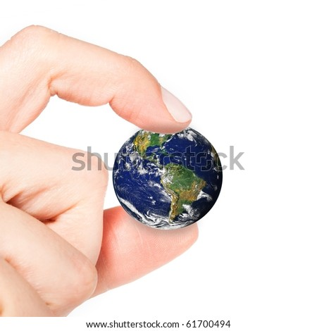 Female hand holding the world close up isolated on white