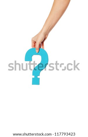 Female hand holding up a turqise question mark against a white background conceptual of questions, query, why or what.
