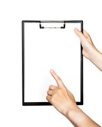 female hand holds a clipboard and points on a free space of a white sheet of paper isolated on white background. space for text. education and business concept