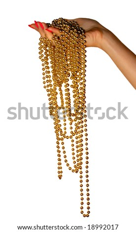 Female hand holds a long gold beads