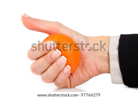 Female hand in a suit squeezing an orange stress ball