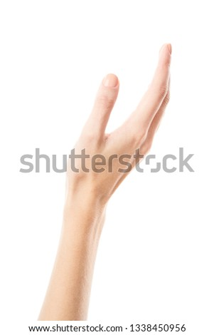 Female hand isolated on white background. White woman's hand showing symbols and gestures. Palm #1338450956