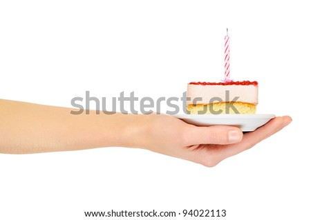 Female hand keep cake with candle. Isolated on white