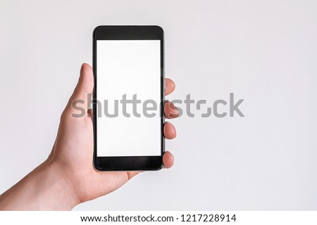 Female hand model mockup with black mobile phone with white screen on isolated background.