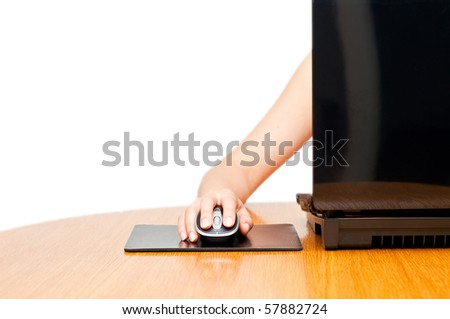female hand on a mouse isolated with laptop screen visible