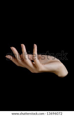 female hand on black background