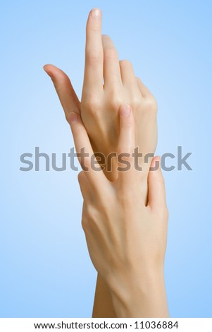 female hand on blue background