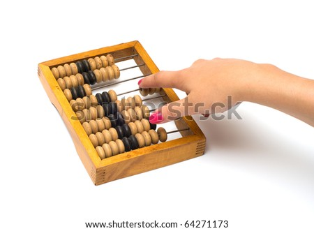 Female hand on old wooden an abacus it is isolated on a white background.