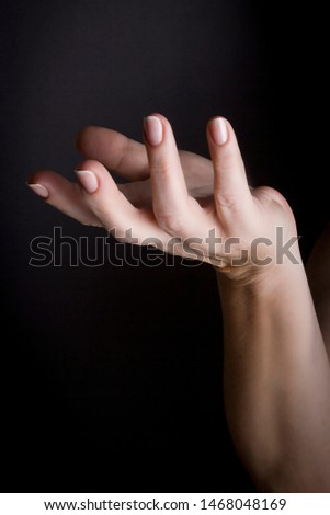 Female hand palm up on a black background #1468048169