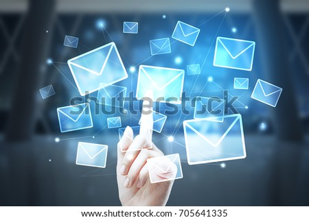 Female hand pointing at abstract digital letter hologram on blurry interior background. E-mail marketing concept. Double exposure