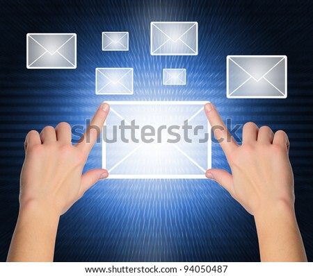 female hand pressing e-mail sign on a touch screen interface over black and blue background - stock photo