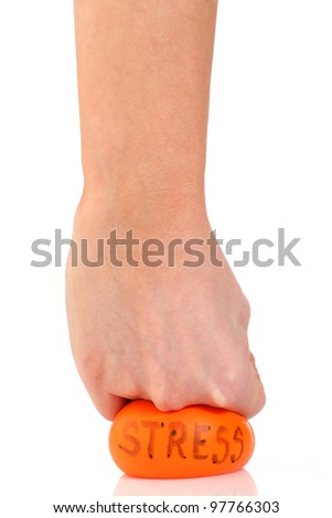 Female hand punching a stress ball in frustration