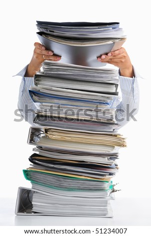Female hand put paper into high pile paperwork