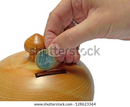female hand putting euro coin in money box