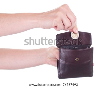 Female hand putting Euro coin into purse
