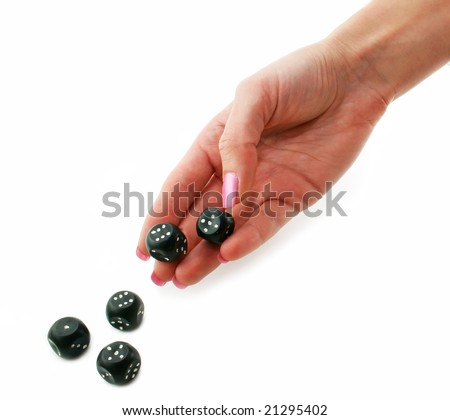 Female hand rolling black dice isolated on a white background