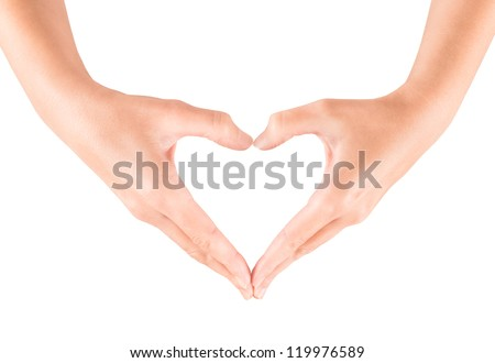 Female hand showing heart shape gesture. Isolated on white.