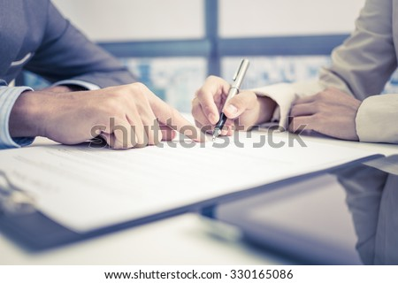 Female hand signing contract. Stock foto ©