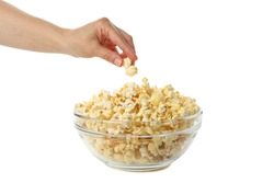 Female hand takes popcorn from bowl, isolated on white background