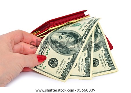 Female hand takes the dollar bill one hundred dollars from a red purse. Isolated on a white background.