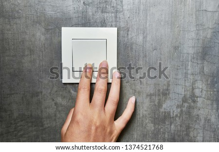 Female hand, to turn off the light, switch, front view. #1374521768
