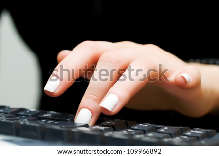 Female hand typing on the computer keyboard