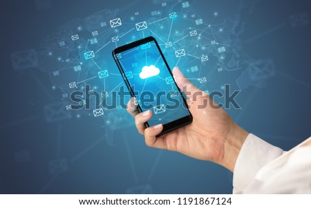 Female hand using smartphone with cloud, message and global concept