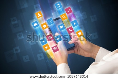 Female hand using smartphone with colorful angular fast switching application icons around #1089648314