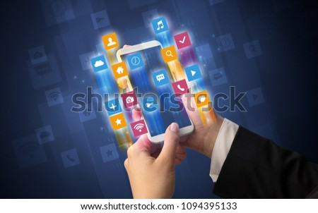 Female hand using smartphone with colorful angular fast switching application icons around #1094395133