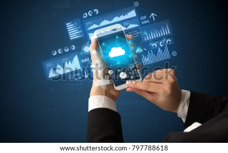 Female hand using smartphone with financial tracking concept illustrated by graphs and symbols #797788618