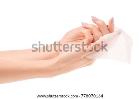 Female hand wet wipe on white background isolation #778070164