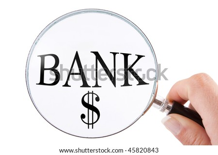 female hand with a magnifying glass isolated searching for a bank against a white background