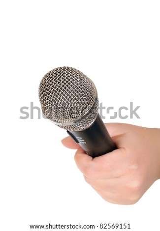 Female hand with a microphone. Isolated over white