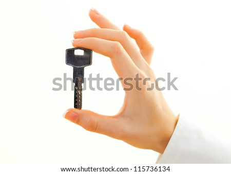Female hand with house key - stock photo