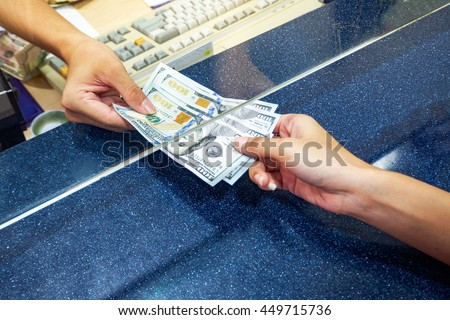 female hand with money in cash...
