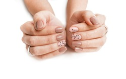 Female hand with nail art isolated on a white background