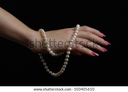 Female hand with pearl beads