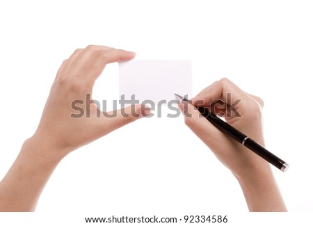 Female hand with pen writing on blank card - stock photo