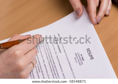 Female hand with professional resume - stock photo