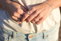 Female hand with silver jewelery, rings and bracelets minimalistic style.