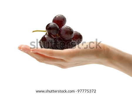 Female hand with some grapes