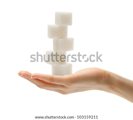 Female hand with sugar cubes