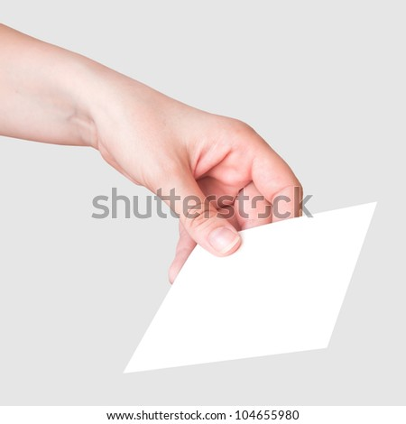 Female hand with the white card on gray background