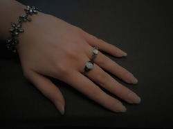 Female Hand with two black gothic style rings. Gothic subculture and fashion concepts.